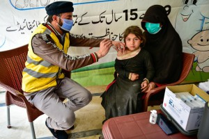 Child receiving vaccine injection in local health center